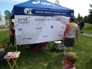 Banner filled with notes of enCOURAGEment signed by runners.